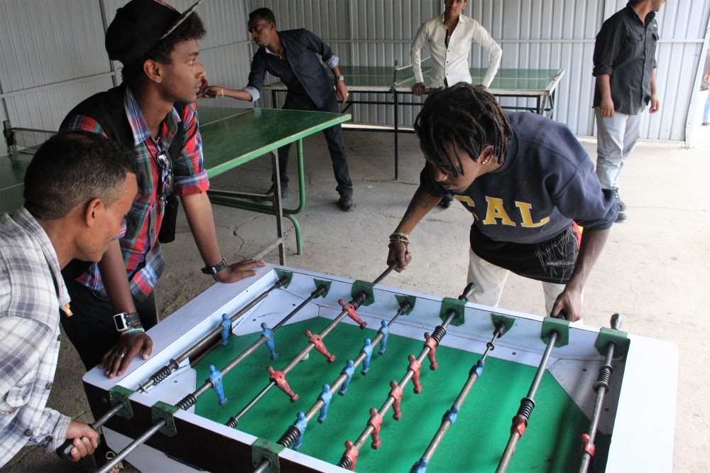 Refugees playing table football