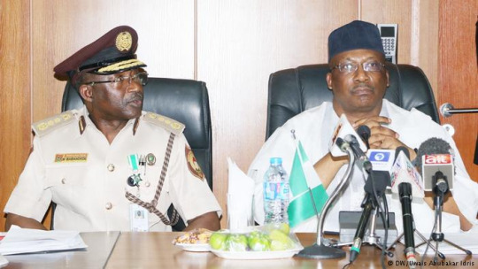 Nigeria's Interior Minister Abdulrahman Dambazau and Comptoller General Mohammed Babandede